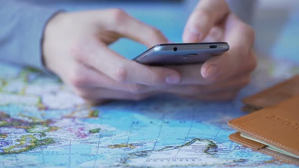 Thumbnail for Man Using Travel App on Smartphone, Buying Tour and Booking Tickets Online