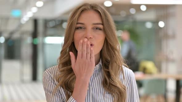 Thumbnail for Portrait of Loving Businesswoman Giving Flying Kiss