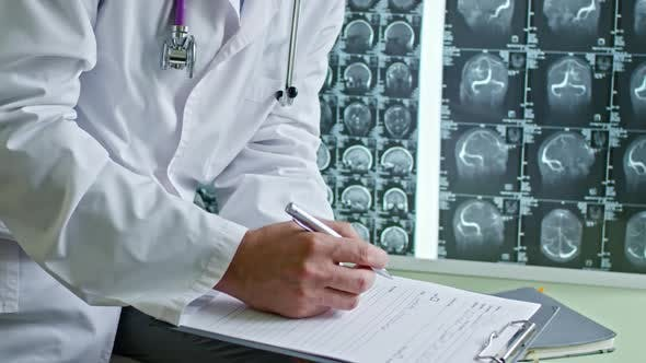 Thumbnail for Male Doctor Filling Medical History
