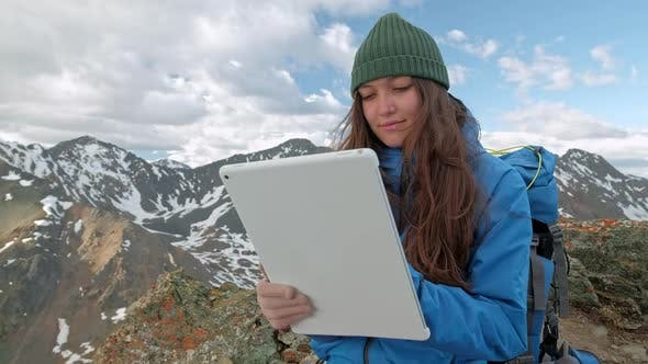 Thumbnail for Tourist Woman Freelancer Uses a Computer in Nature