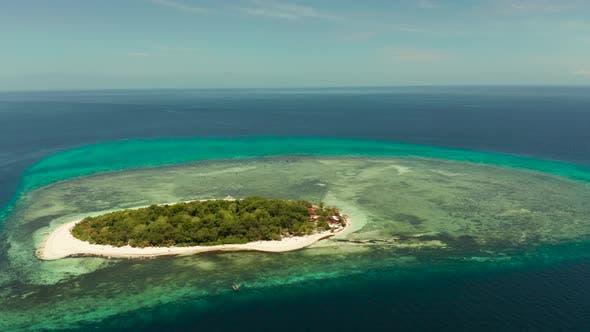 Tropical Island with Sandy Beach. Mantigue Island, Philippines