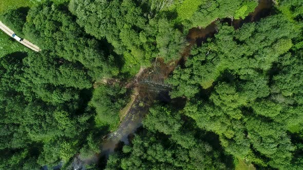 Thumbnail for Aerial Overhead View Of Jeep Car Crossing River In Forest