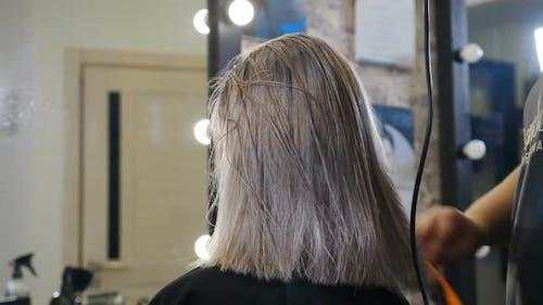 Woman Getting Her Haircut Done
