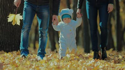 Family Walk in the Autumn Park