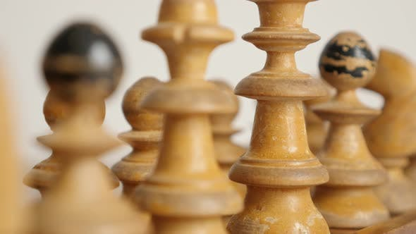 Thumbnail for Queen and king wooden figures on ancient chess playing table  4K 2160p 30fps UltraHD  footage - Whit