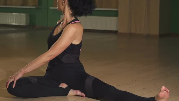 Thumbnail for Gorgeous Flexible Woman Stretching Her Body Doing Yoga