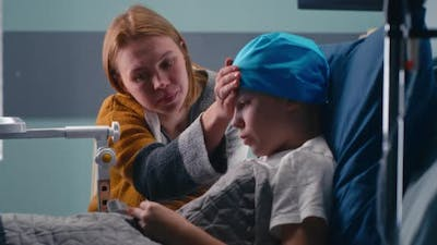 Mother Discussing Illness with Son in Clinic Ward