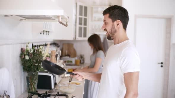 Thumbnail for Happy Man Making Pancakes and Posing
