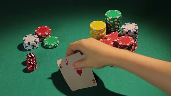 Thumbnail for Poker Player Showing Pair of Aces, Good Chance to Win Big Bank From Rivals