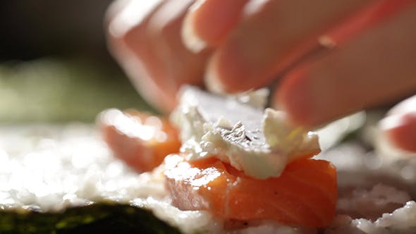 Thumbnail for Making Sushi Rolls With Salmon And Cheese