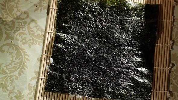 Putting Rice On Nori Making Sushi Rolls