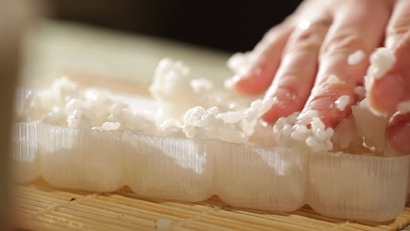 Putting Rice In A Plastic Shape