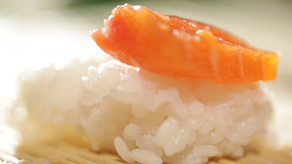 Thumbnail for Putting Piece Of Salmon On Sushi Rice