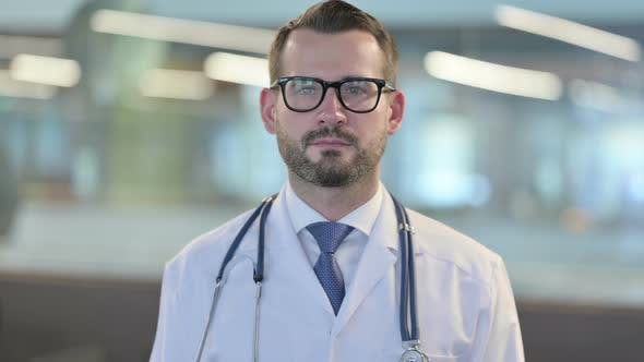 Thumbnail for Portrait of Young Male Doctor Looking at Camera