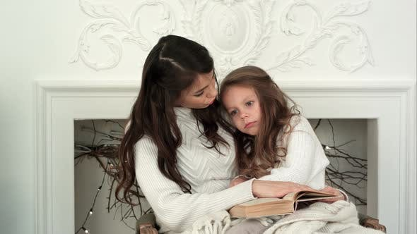 Thumbnail for Little Girl Refusing To Read Christmas Tale Together with Her Mom