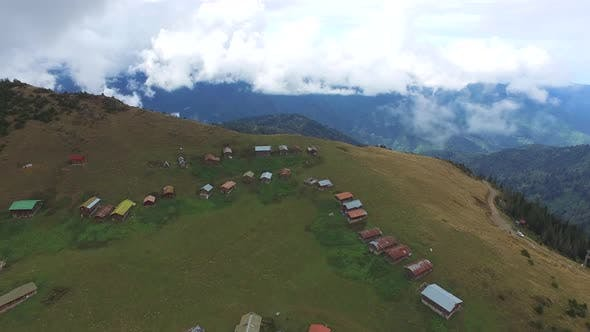 Thumbnail for Colorful Little Plateau Houses In The Meadow Above Top Of The Hill