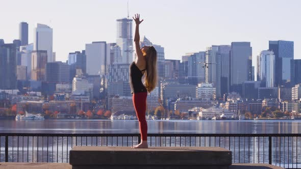 Thumbnail for Amazing Yoga Shot Girl Backbend Stretch Birds And Plane Flying In Front Of City Seattle Wa Skyline