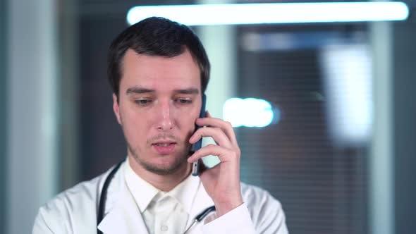 Thumbnail for Doctor Speaks On Smartphone In Office