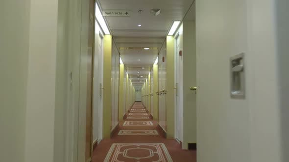 Moving in Hotel Corridor with Light Interior