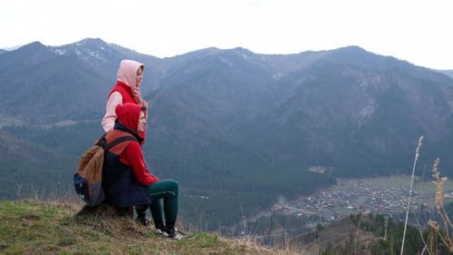 Young Traveler Couple Resting in the Mountains