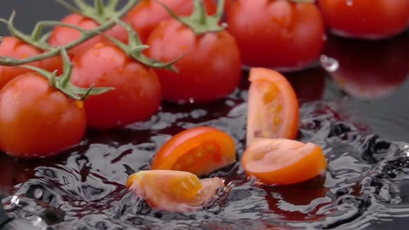 Thumbnail for Slices of Ripe Tomato Falls on the Table