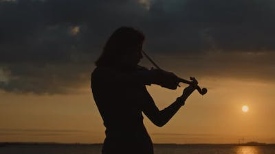 Silhouette of Young Woman Violinist