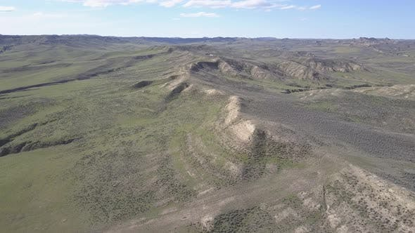 Thumbnail for Aerial Drone Flyover of Prairie Grassland in Wyoming Geology and Hogback Ridge Mountain in Spring