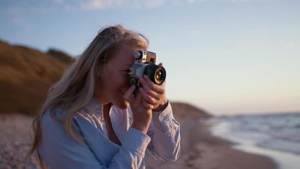 Thumbnail for Photographer Focusing Camera On Beach