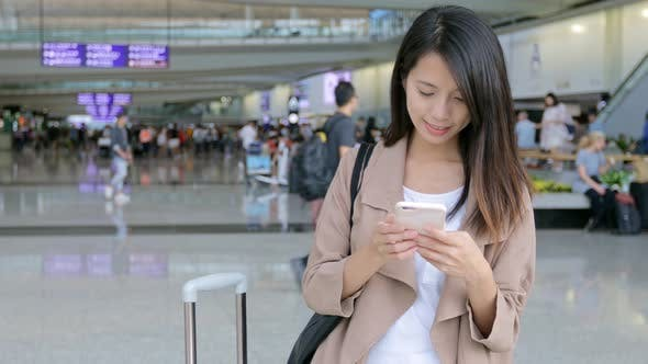 Thumbnail for Travel woman working on her mobile phone in the airport