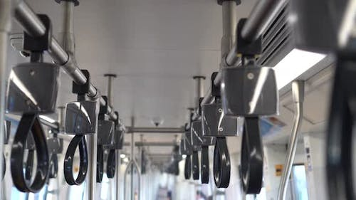 Empty Handrails in a Metro Subway Train  Handle Hand Straps in Public Transportation for Safety
