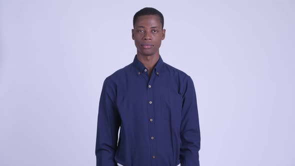 Thumbnail for Young Handsome African Businessman Looking at Camera