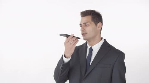 Handsome Businessman Recording Voice Message