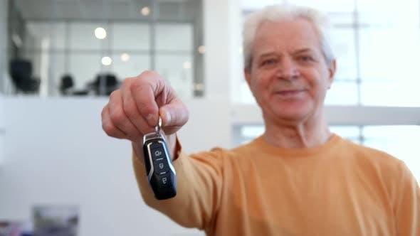 Thumbnail for Senior Man Shakes Car Key in His Hand