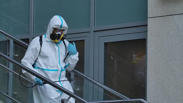 Thumbnail for Man in Protective Suit Disinfects Street with an Antiseptic Sprayer. Surface Treatment Due To