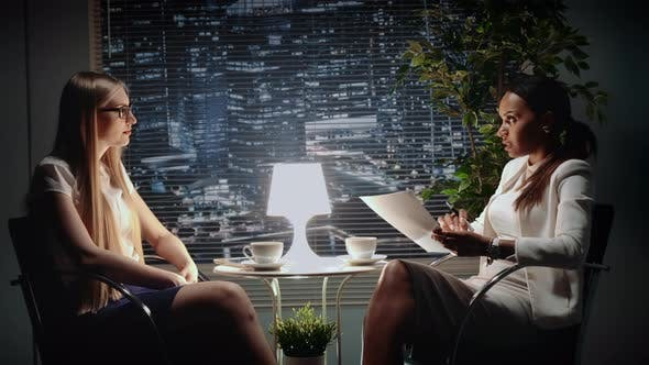 Thumbnail for Two Multiracial Business Women Talking About Business Contract