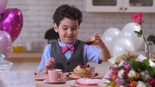 Thumbnail for Happy Toddler Boy Pouring Maple Syrup on Pancakes