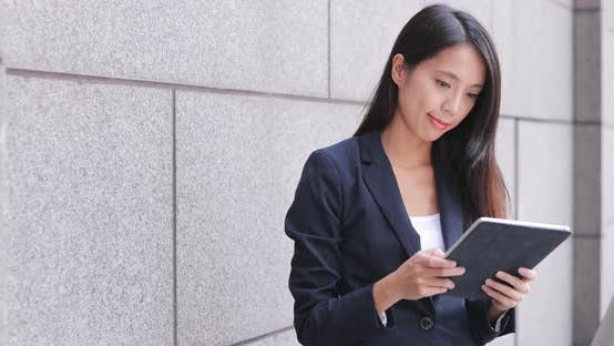 Thumbnail for Businesswoman working on tablet computer