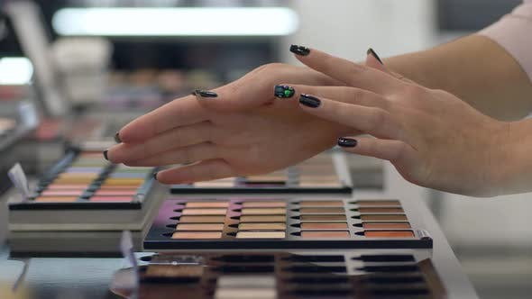 Thumbnail for Professional Cosmetic, Arm of Customer Girl Chooses Eyeshadow From Palette of Different Colors for