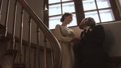 Newlyweds Standing on Staircase and Talking