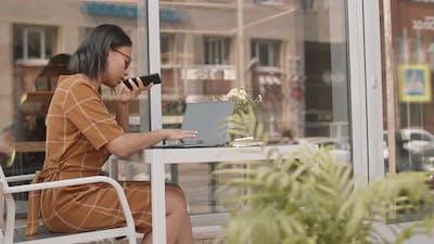 Successful Businesswoman in Summer Cafe