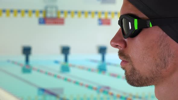Thumbnail for A Professional Swimmer Looks Ahead, Focused, at an Indoor Pool - Face Closeup From the Side
