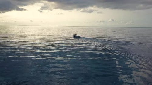 Aerial Drone View. Speed Boat for Tourism Goes in Ocean