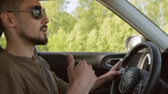 Man Driving Car And Rapping