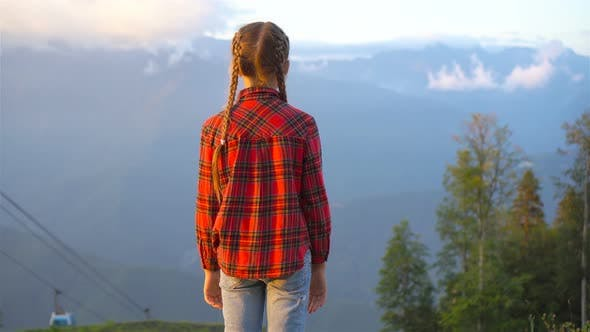 Thumbnail for Beautiful Happy Little Girl in Mountains in the Background of Fog