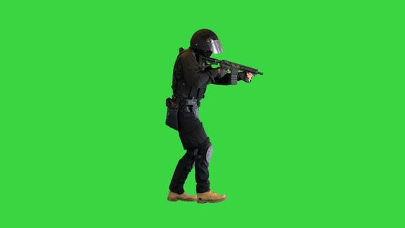 Police Anti Terrorism Squad Fighter Shooting From Rifle on a Green Screen Chroma Key