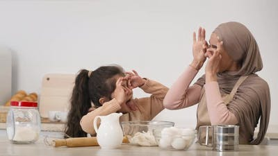 Muslim Mom In Hijab And Daughter Having Fun In Kitchen