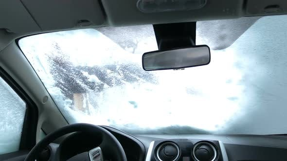 Thumbnail for Cleaning Car Windshield of Snow