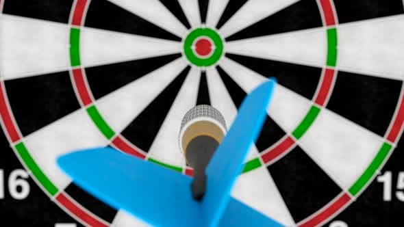 Cover Image for Camera Following Dart Arrow Hitting Bullseye of the Target Slow Motion Close-up
