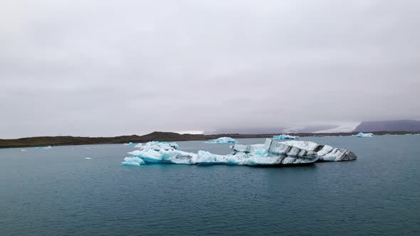 Breathtaking Panoramic Aerial View of Scattered Iceberg and Gray Skies