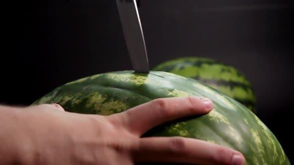 Thumbnail for Man's Hand Cutting Huge Watermelon